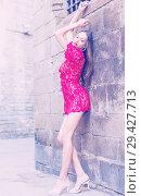 Купить «portrait of sexy young woman in red dress walking in the old city», фото № 29427713, снято 24 июня 2017 г. (c) Яков Филимонов / Фотобанк Лори