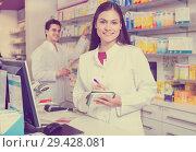 Купить «Pharmacist standing at pay desk», фото № 29428081, снято 19 апреля 2019 г. (c) Яков Филимонов / Фотобанк Лори