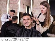 Купить «Woman hairdresser discussing hairstyling with male client», фото № 29428121, снято 5 марта 2018 г. (c) Яков Филимонов / Фотобанк Лори