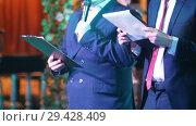 Купить «Two men in costumes announce something.», видеоролик № 29428409, снято 7 августа 2020 г. (c) Константин Шишкин / Фотобанк Лори