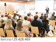 Купить «Business speaker giving a talk at business conference event.», фото № 29428469, снято 15 ноября 2018 г. (c) Matej Kastelic / Фотобанк Лори