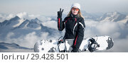 Купить «Young adult woman snowboarder holding snow board», фото № 29428501, снято 18 марта 2018 г. (c) katalinks / Фотобанк Лори