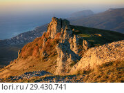 Купить «Beautiful view of the Demerdzhi mountains at sunrise against the backdrop of the sea in the fall in Crimea», фото № 29430741, снято 13 октября 2018 г. (c) Яна Королёва / Фотобанк Лори