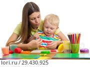 Купить «woman teaches kid handcraft at kindergarten or playschool», фото № 29430925, снято 26 марта 2019 г. (c) Оксана Кузьмина / Фотобанк Лори