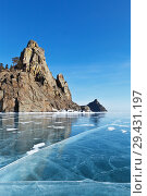 Купить «Lake Baikal in winter. View from the ice on the famous cliffs of the Big and Small Belltowers (Kolokolny) - a natural landmark of the western coast of the lake», фото № 29431197, снято 2 марта 2013 г. (c) Виктория Катьянова / Фотобанк Лори