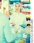 Купить «Female pharmacist counseling customer about drugs usage», фото № 29431265, снято 10 декабря 2018 г. (c) Яков Филимонов / Фотобанк Лори