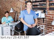 Купить «nail master standing at working place», фото № 29431597, снято 30 мая 2018 г. (c) Яков Филимонов / Фотобанк Лори