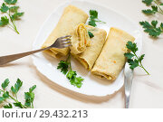 Купить «thin fried pancakes stuffed with stewed cabbage», фото № 29432213, снято 6 ноября 2018 г. (c) Peredniankina / Фотобанк Лори