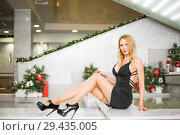 Купить «Young beautiful blond girl with long slim legs», фото № 29435005, снято 17 декабря 2017 г. (c) katalinks / Фотобанк Лори