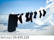Купить «socks and clothes of climbers drying on a rope», фото № 29435229, снято 6 июля 2015 г. (c) katalinks / Фотобанк Лори