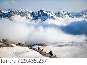 Купить «Clubs of fog and clouds move along», фото № 29435237, снято 8 июля 2015 г. (c) katalinks / Фотобанк Лори
