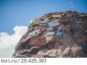 Купить «Stone with memorial signs on the slope», фото № 29435381, снято 5 июля 2015 г. (c) katalinks / Фотобанк Лори
