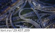 Купить «Aerial view of lighted highway road junctions at night», видеоролик № 29437209, снято 26 октября 2018 г. (c) Яков Филимонов / Фотобанк Лори