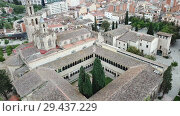 Купить «View from drone of ancient Benedictine abbey in Sant Cugat del Valles, Catalonia, Spain», видеоролик № 29437229, снято 11 июня 2018 г. (c) Яков Филимонов / Фотобанк Лори