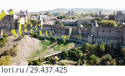 Купить «Aerial view of Carcassonne cityscape with medieval fortress of Cite de Carcassonne, Aude, Occitanie, France», видеоролик № 29437425, снято 6 октября 2018 г. (c) Яков Филимонов / Фотобанк Лори