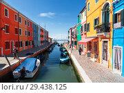 Купить «The urban landscape on the island of Burano with bright colorful buildings, Venice, Italy», фото № 29438125, снято 17 апреля 2017 г. (c) Наталья Волкова / Фотобанк Лори