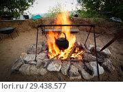 Купить «Boiling kettle hanging over the fire.», фото № 29438577, снято 28 июля 2017 г. (c) Акиньшин Владимир / Фотобанк Лори