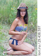 Купить «Slender beautiful girl sitting on the sand in a swimsuit.», фото № 29438597, снято 30 июля 2017 г. (c) Акиньшин Владимир / Фотобанк Лори