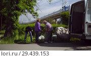 Купить «Mobile receiving point of waste recycling. environmental movement RAZdelniy sbor», видеоролик № 29439153, снято 2 июня 2018 г. (c) Ирина Мойсеева / Фотобанк Лори