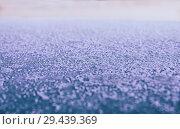 Купить «Фон: гладкая металлическая поверхность, покрытая инеем  и освещенная тусклым утренним светом», фото № 29439369, снято 26 октября 2018 г. (c) Круглов Олег / Фотобанк Лори
