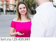 Купить «Young female is flirting with guy», фото № 29439841, снято 18 октября 2017 г. (c) Яков Филимонов / Фотобанк Лори