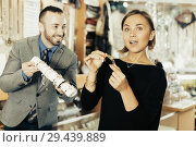 Купить «Portrait of woman customer trying bracelet», фото № 29439889, снято 16 октября 2017 г. (c) Яков Филимонов / Фотобанк Лори