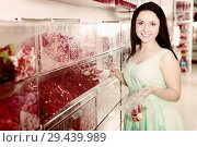 Купить «Pretty girl in sweets store picks up candies in bag», фото № 29439989, снято 25 апреля 2017 г. (c) Яков Филимонов / Фотобанк Лори