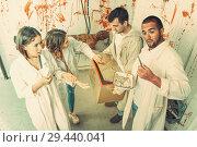 Купить «Young adults in escape room with traces of blood», фото № 29440041, снято 8 октября 2018 г. (c) Яков Филимонов / Фотобанк Лори