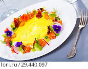 Купить «Delicious ring from tartare salmon with avocado and vegetables, served with flowers», фото № 29440097, снято 18 июня 2019 г. (c) Яков Филимонов / Фотобанк Лори