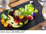 Купить «Deliciously salad of raw tuna with avocado, mango and greens at plate», фото № 29440237, снято 19 декабря 2018 г. (c) Яков Филимонов / Фотобанк Лори