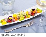 Купить «Fried tuna with fruits, vegetables and greens», фото № 29440249, снято 15 ноября 2019 г. (c) Яков Филимонов / Фотобанк Лори