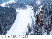 Top view of a frozen river in a snowy wooded rocky canyon. Стоковое фото, фотограф Евгений Харитонов / Фотобанк Лори