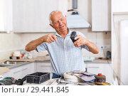 Купить «Man engaged in renovation work», фото № 29441845, снято 19 июня 2018 г. (c) Яков Филимонов / Фотобанк Лори