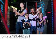 Купить «Parents and children playing laser tag», фото № 29442281, снято 6 июня 2018 г. (c) Яков Филимонов / Фотобанк Лори
