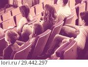 Cheerful group expecting movie to begin. Стоковое фото, фотограф Яков Филимонов / Фотобанк Лори