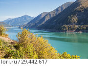 Купить «Zhinvali Reservoir on Aragvi River in Georgia. Beautiful landscape in autumn sunny day», фото № 29442617, снято 24 сентября 2018 г. (c) Юлия Бабкина / Фотобанк Лори