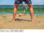 Купить «Little handsome boy kicks the ball on the beach on a summer sunny day.», фото № 29443461, снято 26 июля 2018 г. (c) Акиньшин Владимир / Фотобанк Лори