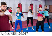 Купить «group of sporty women and their trainer are boxing in gym», фото № 29450017, снято 8 октября 2017 г. (c) Яков Филимонов / Фотобанк Лори