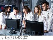 Купить «Five adults solving conundrums together in quest room in view as abandoned lab», фото № 29450221, снято 6 июля 2017 г. (c) Яков Филимонов / Фотобанк Лори