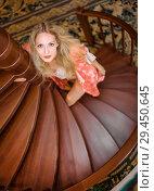 Купить «girl in silk robe stand on wooden spiral staircase», фото № 29450645, снято 26 апреля 2017 г. (c) katalinks / Фотобанк Лори