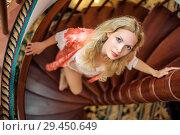 Купить «girl in silk robe stand on wooden spiral staircase», фото № 29450649, снято 26 апреля 2017 г. (c) katalinks / Фотобанк Лори