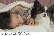 Купить «Beautiful teen girl sleeping sweetly in bed with dog and cat», фото № 29451105, снято 19 марта 2019 г. (c) Юлия Машкова / Фотобанк Лори