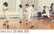 Купить «Boys and adults practicing fencing techniques», фото № 29456305, снято 30 мая 2018 г. (c) Яков Филимонов / Фотобанк Лори