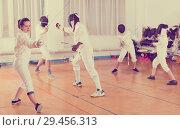 Купить «Woman wearing fencing uniform practicing with foil», фото № 29456313, снято 30 мая 2018 г. (c) Яков Филимонов / Фотобанк Лори