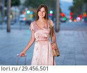Купить «Young traveling woman going to the historic city center», фото № 29456501, снято 26 августа 2017 г. (c) Яков Филимонов / Фотобанк Лори
