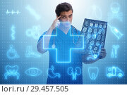 Купить «Doctor looking at x-ray image in telehealth concept», фото № 29457505, снято 26 марта 2019 г. (c) Elnur / Фотобанк Лори
