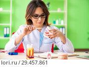 Купить «Woman dentist working on teeth implant», фото № 29457861, снято 11 июня 2018 г. (c) Elnur / Фотобанк Лори