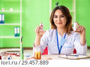 Купить «Woman dentist working on teeth implant», фото № 29457889, снято 11 июня 2018 г. (c) Elnur / Фотобанк Лори