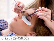 Купить «Young woman getting eyelash extension», фото № 29458005, снято 29 января 2018 г. (c) Elnur / Фотобанк Лори