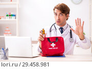 Купить «Young doctor with first aid kit in hospital», фото № 29458981, снято 23 августа 2018 г. (c) Elnur / Фотобанк Лори